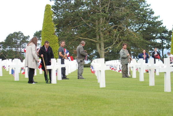 D-Day, 2014 decorating graves at the American Cemetery
