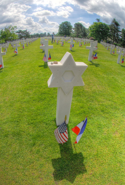 Decorating a Jewish grave at the American Cemetery, D-Day, 2014