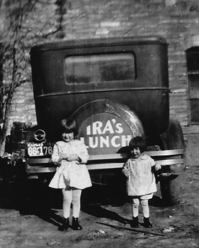 Ira Armsbury's car, parked behind his restaurant, Ira's Lunch, in Lincoln, Kansas. Circa 1933