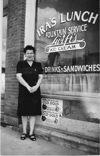 Wava Farrington, in front of Ira's Lunch, Lincoln, Kansas. Date unknown.